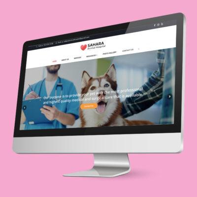 Sahara Animal Hospital's website on a mock-up computer.